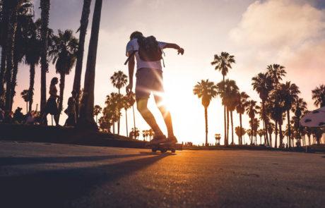 skateboarder skating into the sunset